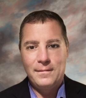 John Caragliano (Photo: Business Wire)