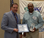 Albert McShan (right), Energy Coordinator for Cooper's Tupelo plant, accepts the enHance Leader award from Mississippi Department of Environmental Quality Executive Director Gary Rikard. (Photo: Business Wire)