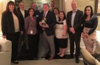 PPG and Olympic Forest Products representatives join Radhika Batra (front, second from left), PPG vice president, global supply management, and Dan Andrews (holding trophy), owner/president, Olympic Forest Products, to celebrate the pallet-services company's recognition as winner of the first PPG Supplier Sustainability Award. (Photo: Business Wire)