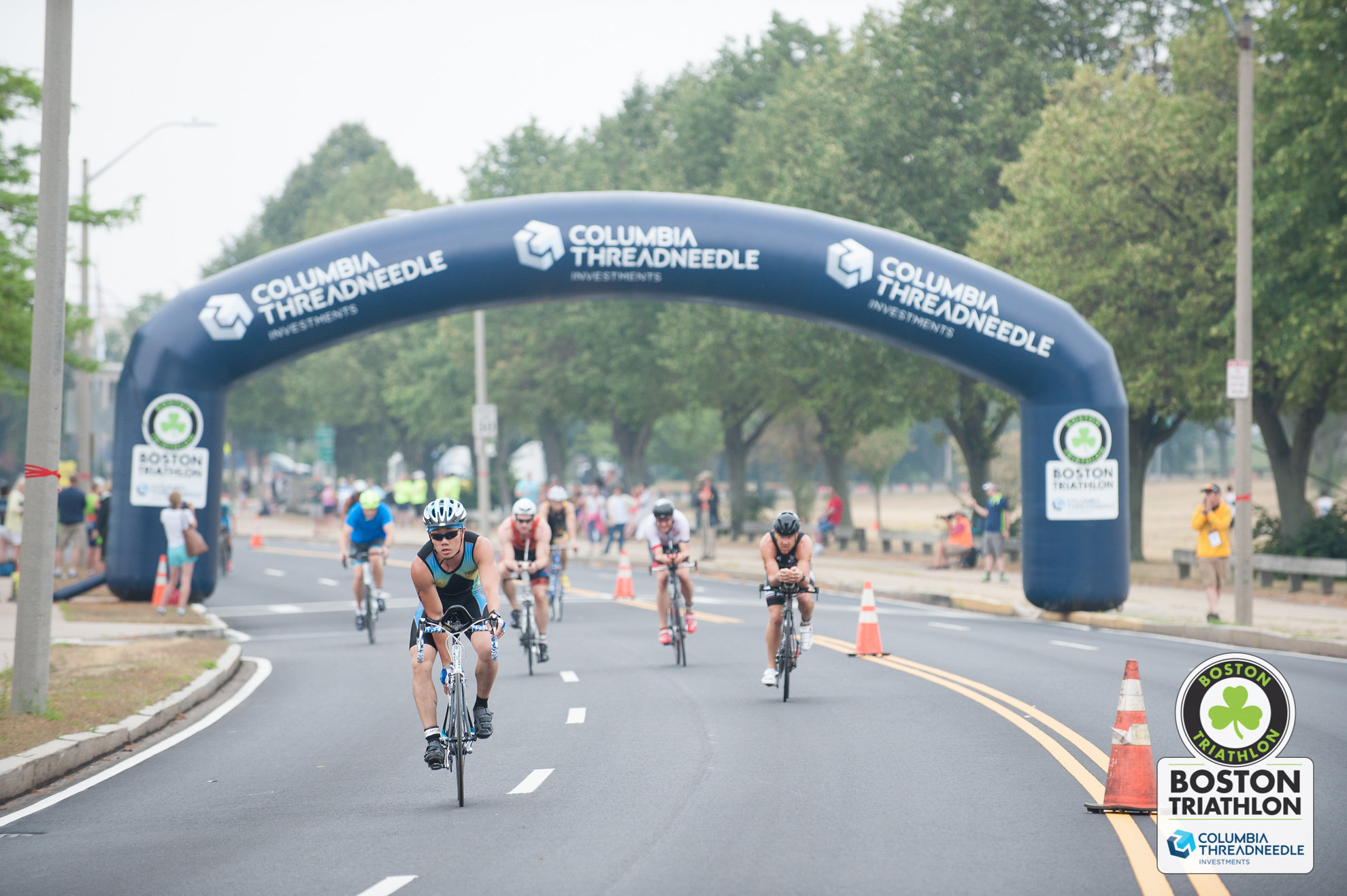 Cyclists ride under the Columbia Threadneedle arch on the streets of South Boston during the 2016 Columbia Threadneedle Investments Boston Triathlon (Photo: Columbia Threadneedle Investments)