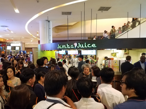 Guests gather at the grand opening celebration of Jamba Juice Thailand in Siam Paragon Mall, Bangkok ...