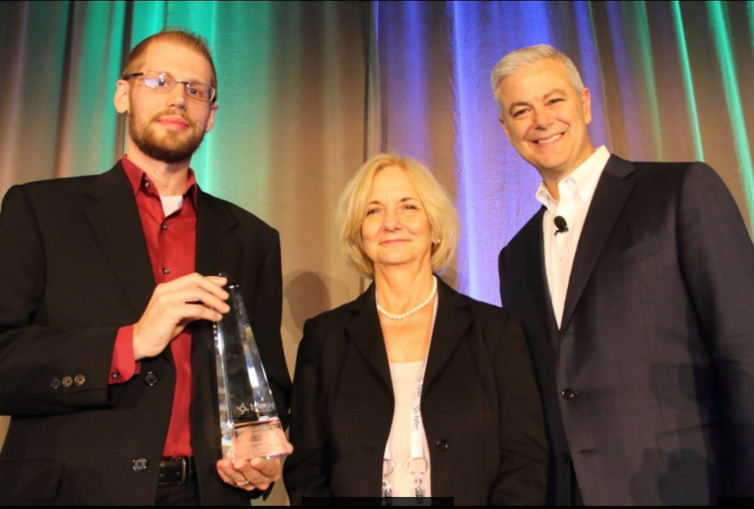 Superior Court of California, County of Fresno's Kevin Anderson and Patty Wallace Rixman accept their award from Tyler's Bruce Graham. (Photo: Business Wire)