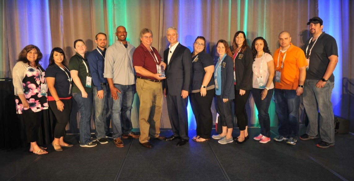 Representatives from Grayson County, Texas, accept their award from Tyler's Bruce Graham. (Photo: Business Wire)