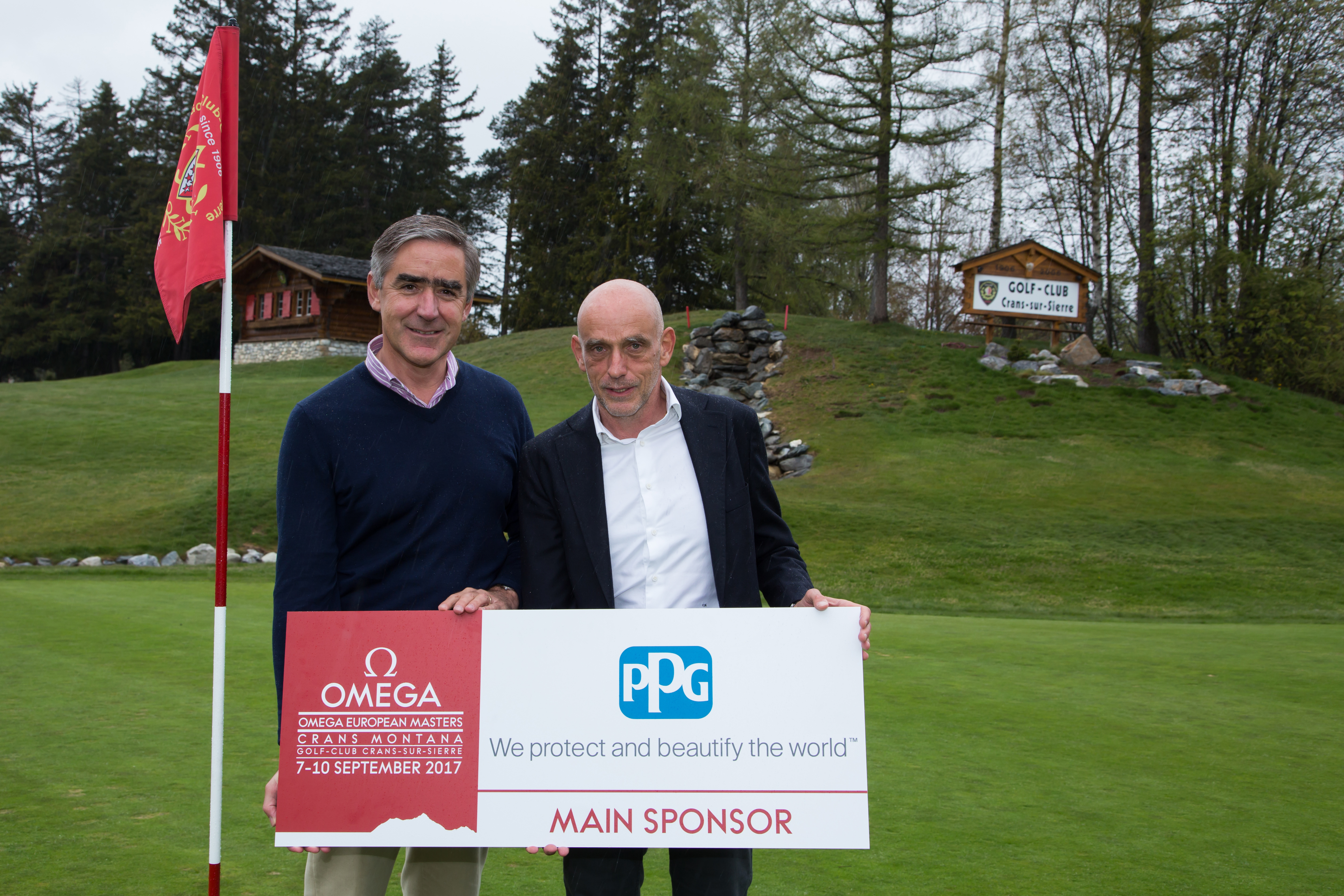 Jean-Marie Greindl (left), PPG senior vice president, global architectural coatings, and president, PPG Europe, Middle East and Africa, and Tournament Director Yves Mittaz, at Omega European Masters Golf organization, celebrate PPG's sponsorship of the Omega European Masters Golf Championship, scheduled for 7-10 September at the Crans-sur-Sierre Golf-Club in Crans-Montana, Switzerland. (Photo: Business Wire)