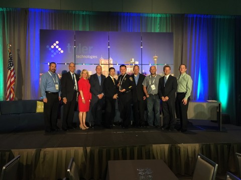 Representatives from the Oxnard Police Department, California, accept their award from Tyler Technol ...