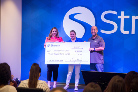 Stream CEO Larry Mondry and Senior Events Manager Kimberly Girard Present Check to the American Red Cross' Natalie Butters (left) (Photo: Stream)