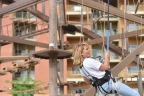 After making it to the top of the rock-climbing wall, actress and mom Candace Cameron Bure takes in the sights during her descent at Kalahari Resorts and Conventions in Sandusky, Ohio. (Photo: Business Wire)