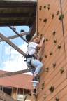 Candace Cameron Bure tackles the rock-climbing wall at Kalahari Resorts and Conventions in Sandusky, Ohio. The actress and mom was on-hand as the resort unveiled five new slides at that property. (Photo: Business Wire)
