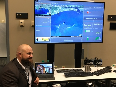 Nathan Hopper of Navy Research Laboratory, showing Operations Dashboard, the user interface for the unmanned systems operational demonstration, built on ArcGIS Online. (Photo: Business Wire)