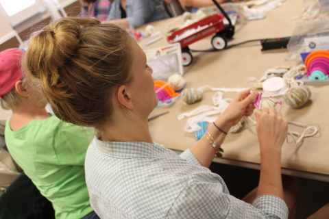 A JOANN workshop attendee works diligently on her project. (Photo: Business Wire)