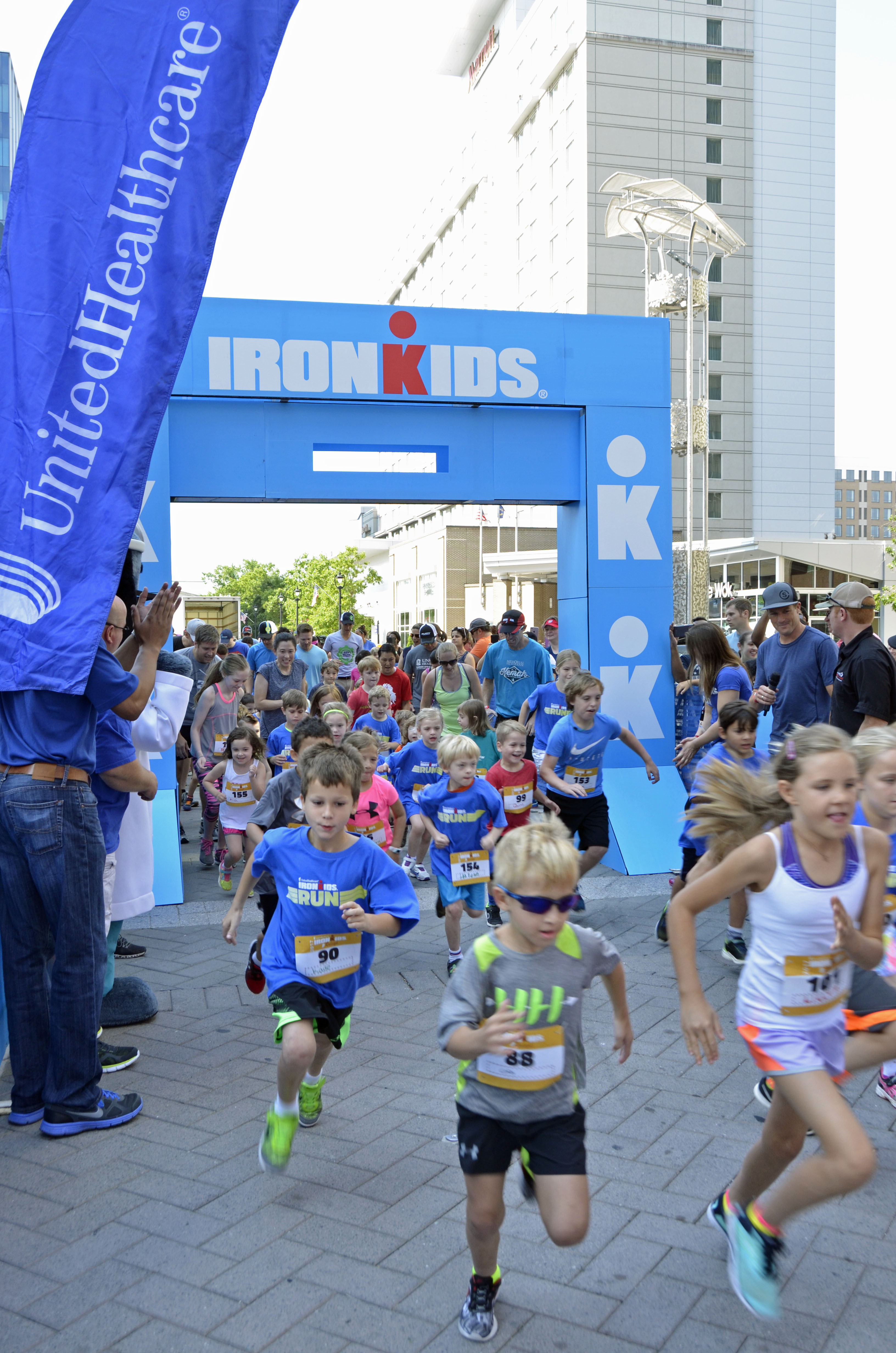 More than 160 kids crossed the finish line at the UnitedHealthcare IRONKIDS Raleigh Fun Run today at Raleigh Marriott City Center. UnitedHealthcare mascot Dr. Health E. Hound helped Derek K. Harris Jr. of UnitedHealthcare and state Rep. Duane Hall kick off the fun run. This is the sixth year UnitedHealthcare is sponsoring IRONKIDS races in the United States. (Photo credit: Marc Kawanishi)