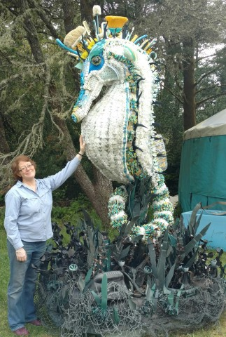 "Lead Artist Angela Haseltine Pozzi stands near her marine debris sculpture of ""Stella the Seahorse"" as displayed by Washed Ashore at the United Nations Ocean Conference, June 5-9, 2017, in New York. (Photo: Business Wire)"