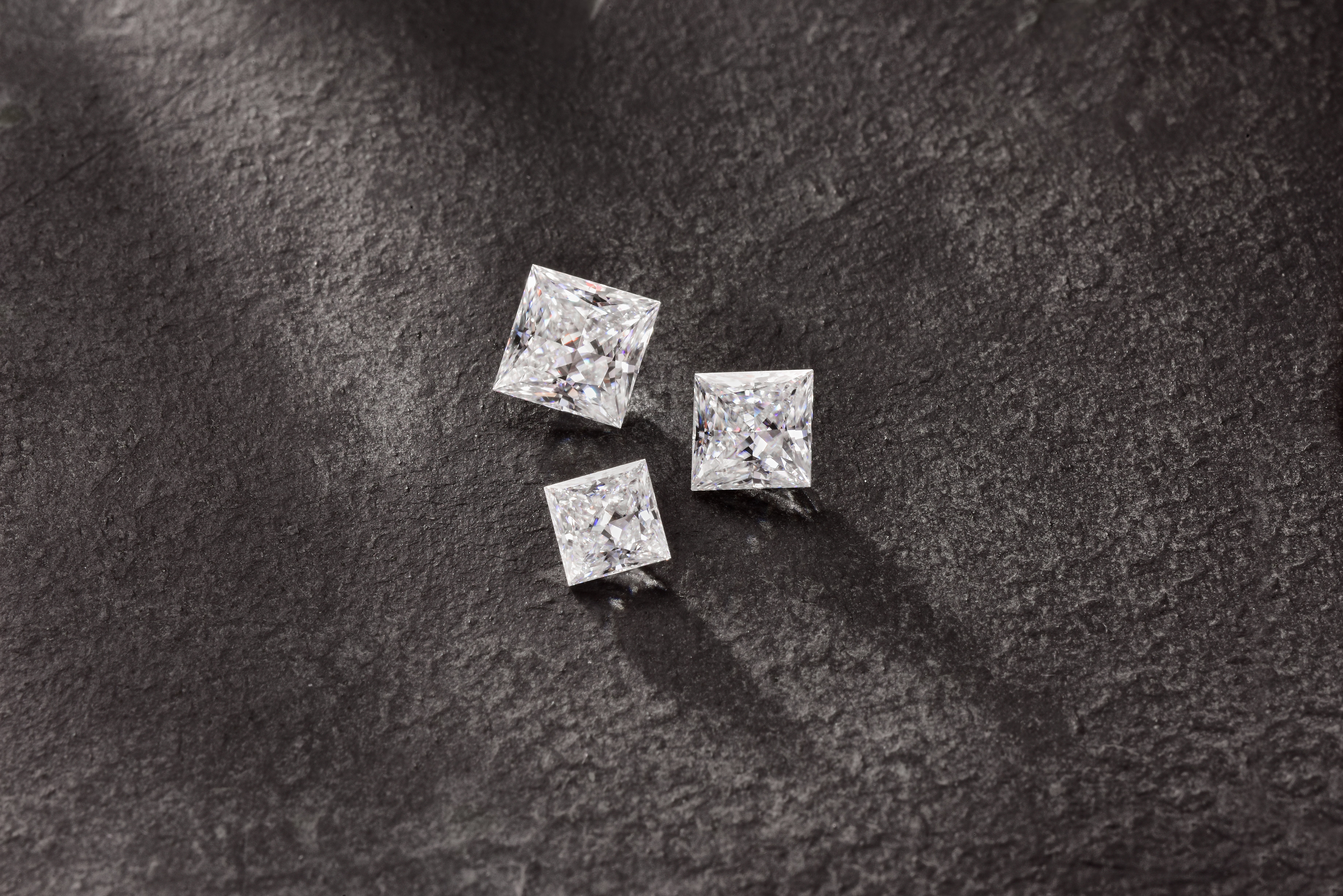 Charles & Colvard Forever One Moissanite Princess Cut Gemstones (Photo: Business Wire)
