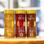 From June 4 – June 24, three flavors of Argo Tea – Carolina Honey®, Green Tea Ginger Twist® and Hibiscus Tea Sangria® - will be featured on display at Walgreens nationwide in honor of National Iced Tea Month.  During the period, Argo Tea will donate 10 percent of profits of their bottled teas sold at Walgreens to Stupid Cancer. (Photo: Business Wire)