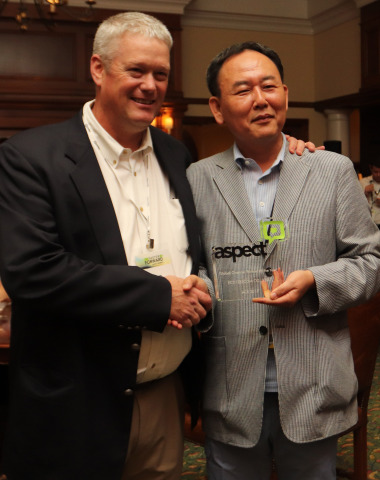 Tom Chamberlain, VP Sales Operations at Aspect Software, presents Mr. H.N. Hyon, CEO of ECS, with th ...
