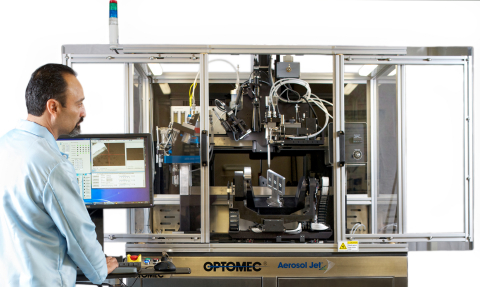 Aerosol Jet 5 Axis System, printing antennas and sensors on three cell phone inserts. (Photo credit: Optomec)