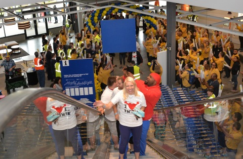 First customers Felicia Andes and Kenneth Heyward are greeted by IKEA Columbus coworkers in celebration of the store's grand opening this morning. (Photo: Business Wire)