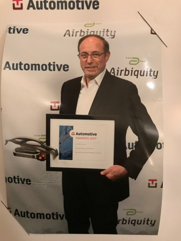 Ami Dotan, CEO of Karamba Security, accepting TU-Automotive's award for Best Auto Cybersecurity Product/Service on June 6. (Photo: Business Wire)