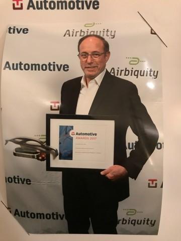 Ami Dotan, CEO of Karamba Security, accepting TU-Automotive's award for Best Auto Cybersecurity Prod ...