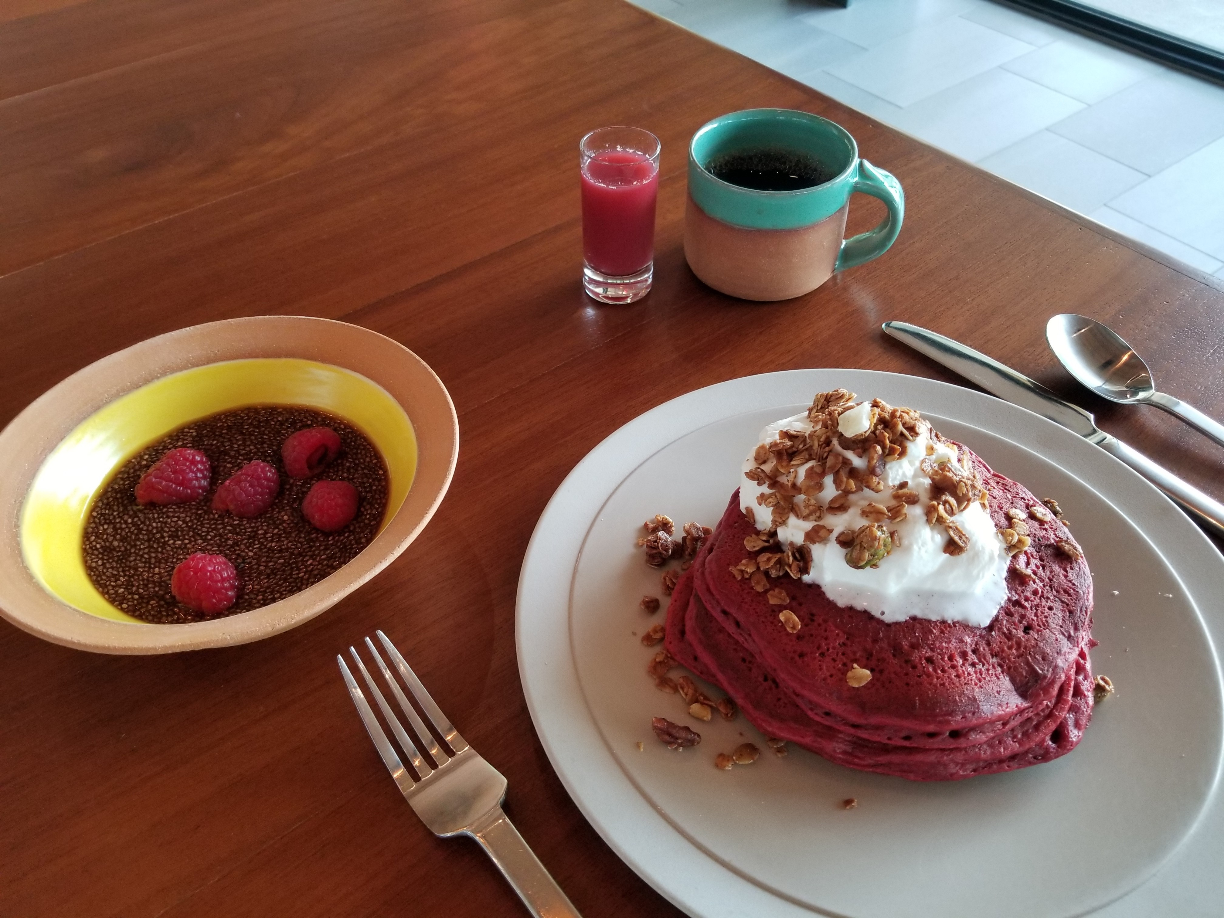 Andaz Scottsdale's Red Velvet Pancakes with Whip Cream and House Made Granola accompanied by Pomegranate Chia Seed Pudding. The hotel is participating in the EAT (RED) SAVE LIVES campaign, and every order of this special breakfast triggers a $3 donation from the hotel that goes directly to (RED)'s fight. (Photo: Business Wire)