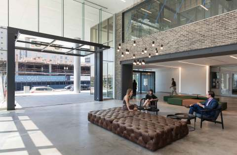 A large, garage-style door that connects interior and outdoor areas is a highlight of the renovations that helped drive over 150,000 square feet of leasing at 80 M Street in Washington, D.C., owned by Columbia Property Trust. (Photo: Business Wire)