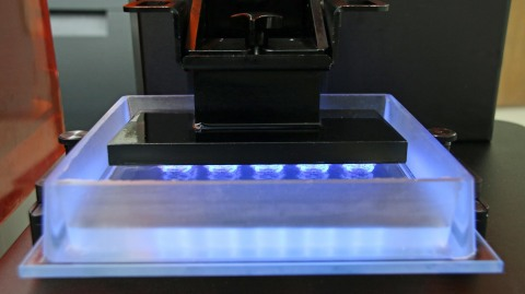 The new M-Type material tray for EnvisionTEC's Micro and Vida desktop 3D printers lasts about 3-4 months and is disposable. The bottom is optical glass coated in a film that allows for easy separation of exposure layers, surrounded by a soft but firm silicone frame. (Photo: Business Wire)