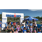 More than 220 kids participated in the UnitedHealthcare IRONKIDS Boulder Fun Run today at Boulder High School. UnitedHealthcare mascot Dr. Health E. Hound helped UnitedHealthcare Vice President Grant Snyder and IRONMAN pro-athlete Mirinda Carfrae kick off the fun run. This is the sixth year UnitedHealthcare is sponsoring IRONKIDS races in the United States (Video: Anita Sen).