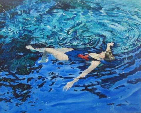 """Swimmer #7,"" by John Briggs, depicting a woman floating peacefully on crystal blue water. This is among many works in the Rembrandt/Meek exhibition at the Polk Museum of Art at Florida Southern College. (Photo: Business Wire)"
