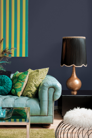 The PPG Paints brand's 2018 Color of the Year, Black Flame, acts like a black curtain, allowing other décor elements to take center stage. (Photo: Business Wire)