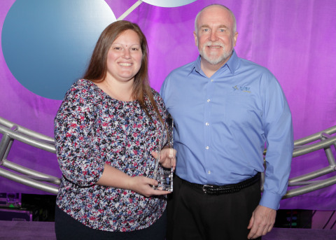 Cynthia Hudson from the Newton County School System accepts the Excellence Award from Tyler's Ted Thien. (Photo: Business Wire)