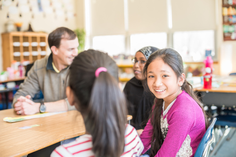 Unum employees serve as reading mentors to students from Presumpscot School in Portland, Maine. (Pho ...