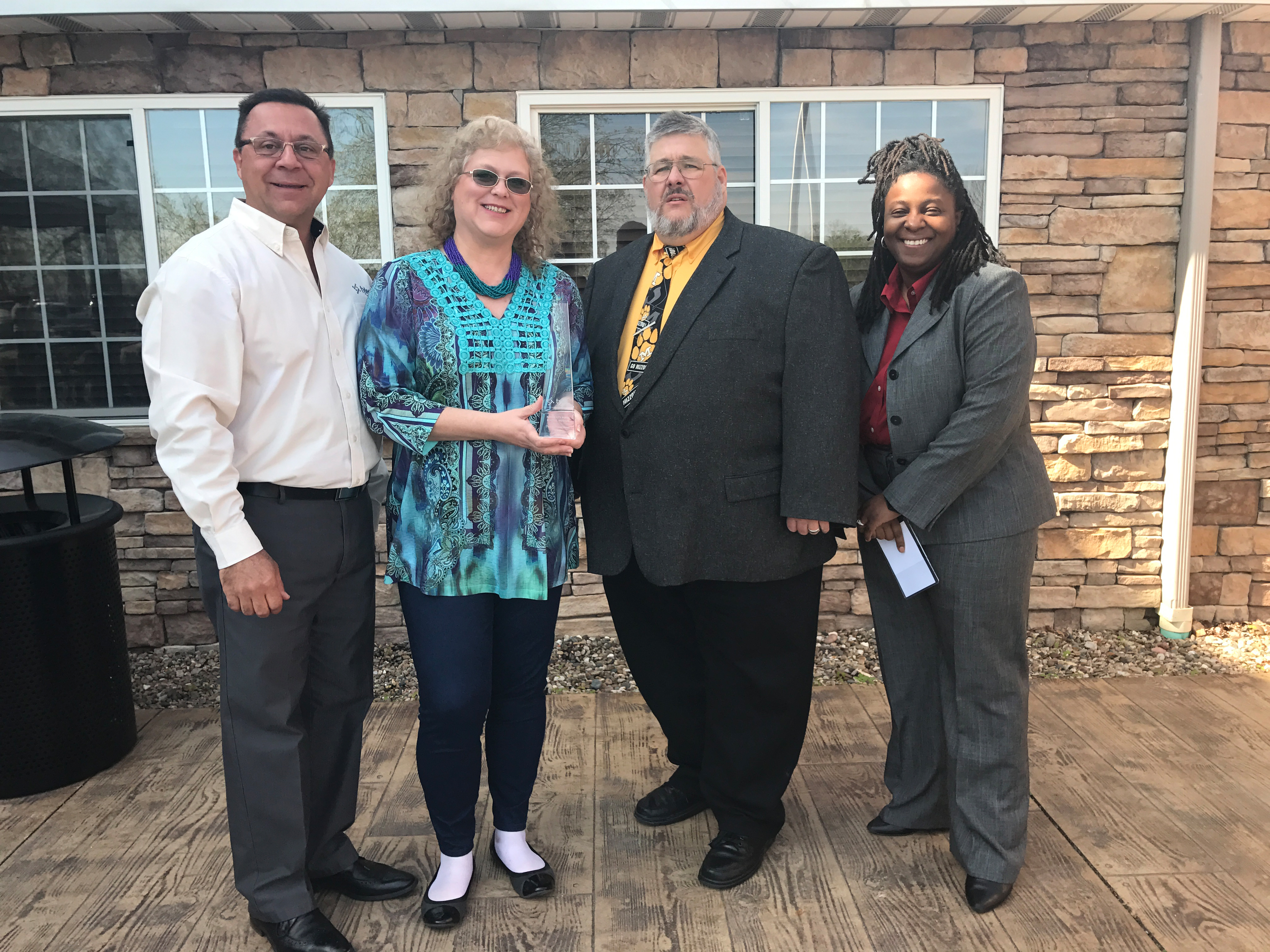 Representatives from Kansas City Public Schools, Missouri, accept their Excellence Award at the Tyler SIS user conference in Columbia, Missouri. (Photo: Business Wire)