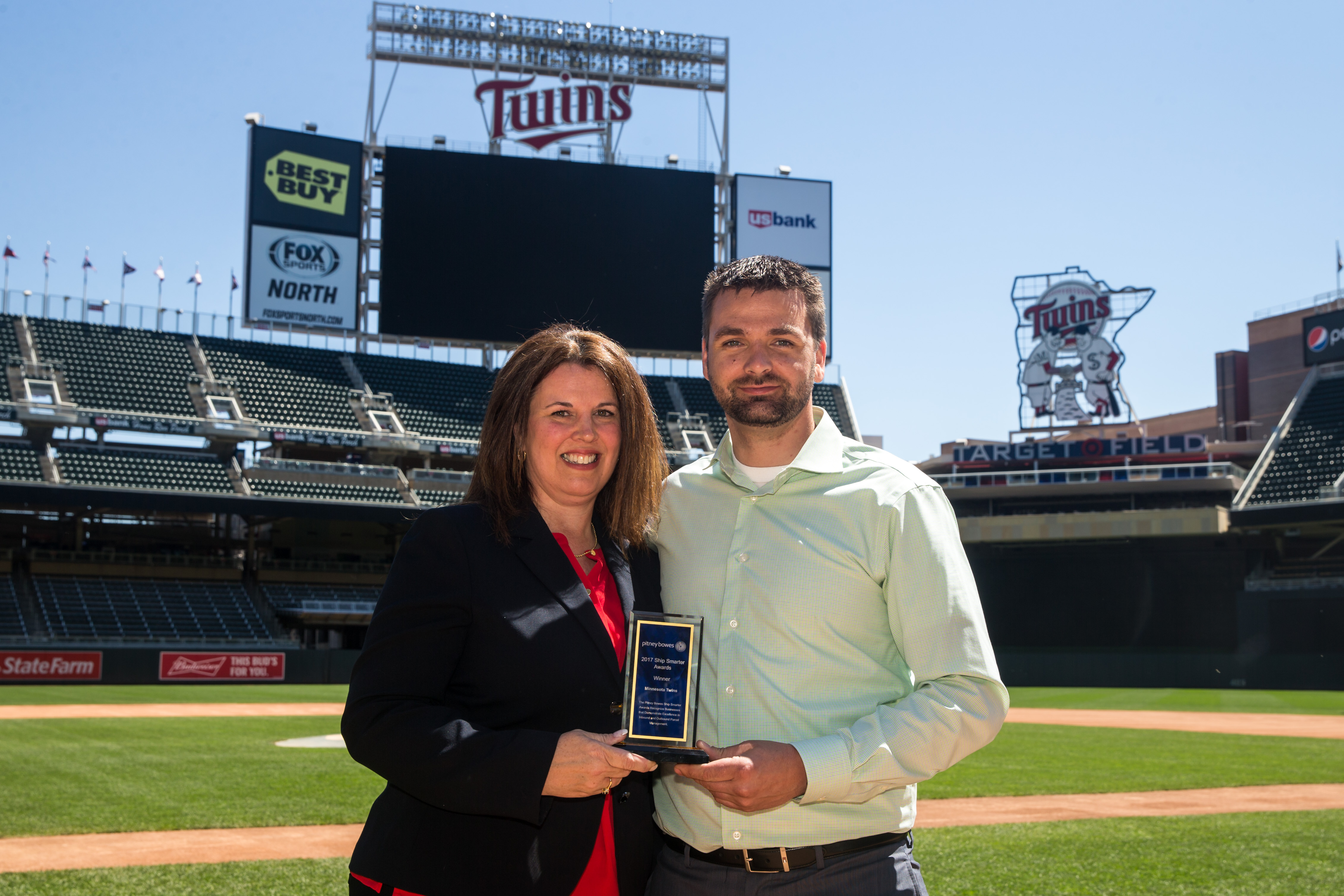 Minnesota Twins -- From left to right: Kelly George, Major Account Manager, Pitney Bowes and Josh Fallin, Office Services Coordinator, Minnesota Twins (Photo: Business Wire)