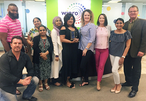 Wipro -- From left to right: Robert Hollenfer, Executive, GIMS, Wipro; Peter Thomas, Executive, GIMS, Wipro; Binu Raji, Manager, HRSS, US Operations, Wipro; Rachel Thomas, Executive, GIMS, Wipro; Rabia Chaudhry, Executive, HRSS, US Operations, Wipro; Diana Rosado, Office Manager, International Operations, Wipro; Monique DiLiberto, Executive Assistant, Communications, Wipro; Destini Gonzales, Operations Manager, International Operations, Wipro; Priyanka Chinnari, Executive, GIMS, Wipro; and Tom Hazel, North American Channel Director, Pitney Bowes (Photo: Business Wire)