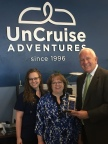 UnCruise Adventures -- From left to right: Juniper Rayne, Fulfillment Coordinator, UnCruise Adventures; Wendy Wilford, Marketing Manager, UnCruise Adventures; and Doug MacDonald, Major Accounts Manager, Pitney Bowes (Photo: Business Wire)