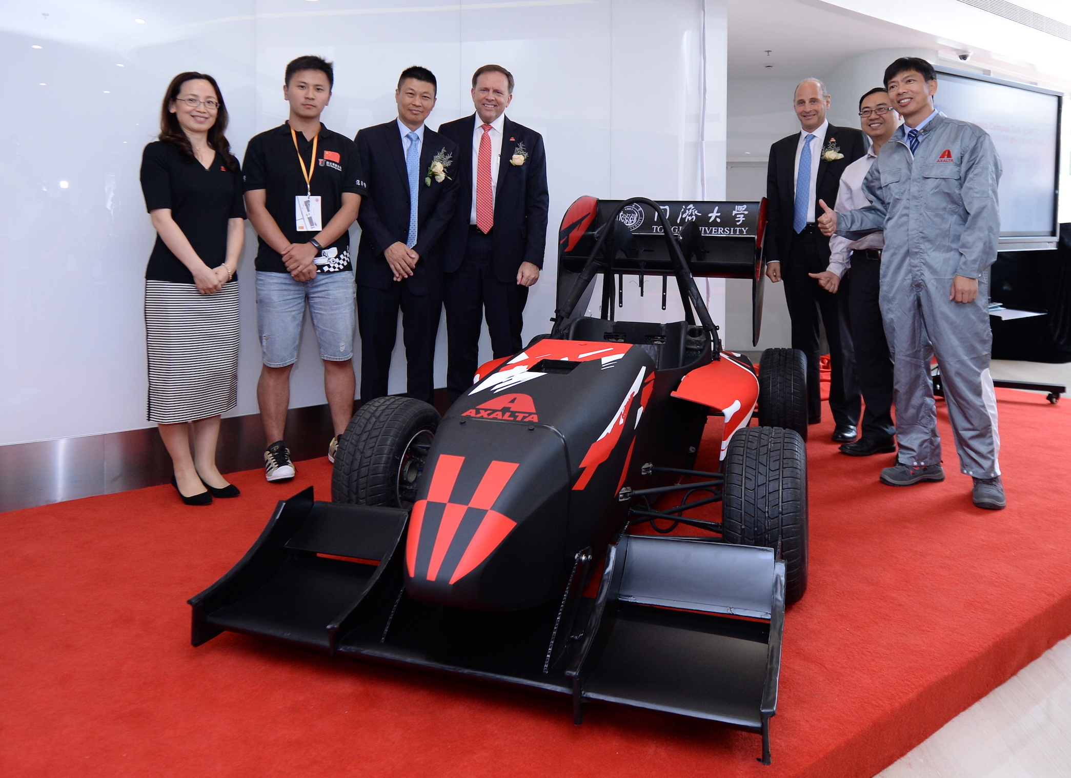 Members of Axalta and Shanghai Tongji University celebrate the university team race car which was painted with Axalta's Spies Hecker® refinish products. (Photo: Axalta)