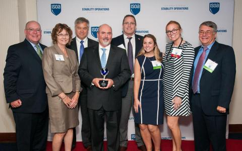 Comprehensive Health Services representatives pose at the June 1st ISOA Award Dinner with the Tier 3 Vanguard Award. (Photo: Business Wire)