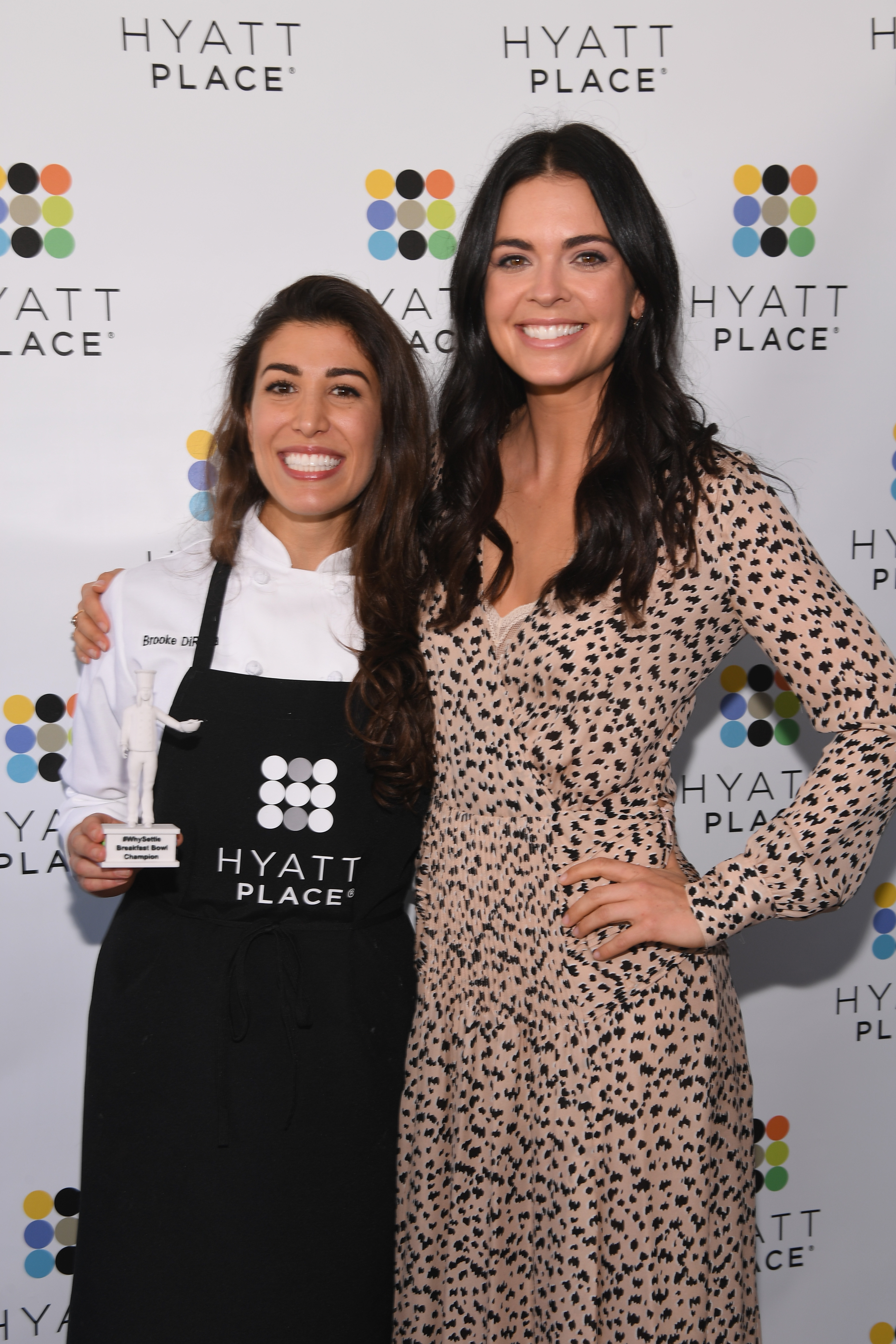 NEW YORK, NY - JUNE 20: TV Host and Celebrity Chef Katie Lee (R) teams up with Hyatt Place to award Institution of Culinary Education student chef Brooke DiResta $10,000 for winning the Hyatt Place #WhySettle Battle of the Breakfast Bowls student chef competition at Hyatt Place New York/Midtown-South on June 20, 2017 in New York City. (Photo by Dave Kotinsky/Getty Images for Hyatt Place)
