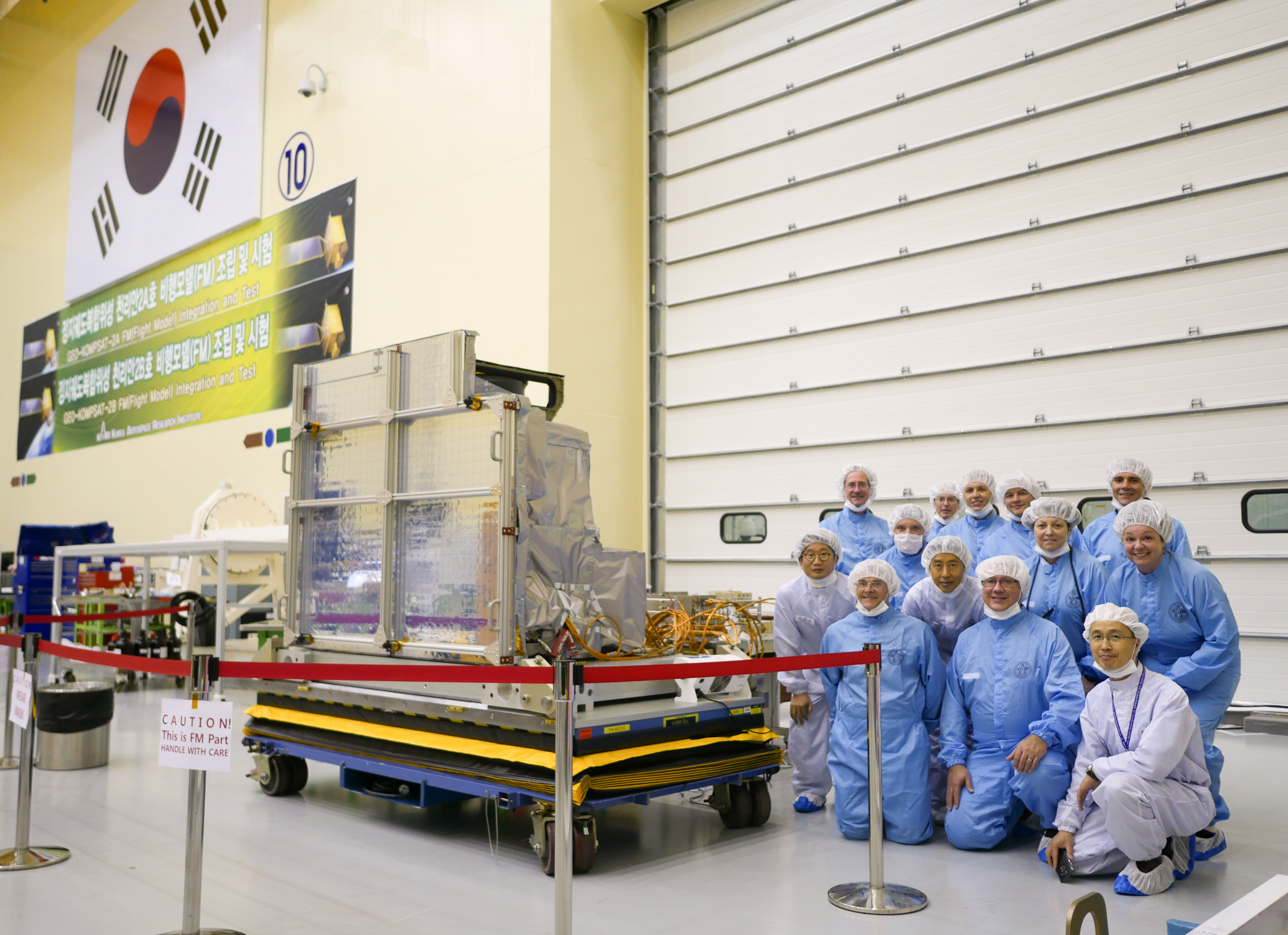 Korea Aerospace Research Institute (KARI) and Harris Corporation employees pose with the Advanced Meteorological Imager, which was built by Harris in Fort Wayne, Ind., and was recently delivered to KARI for integration into its newest weather satellite. (Photo: Business Wire)