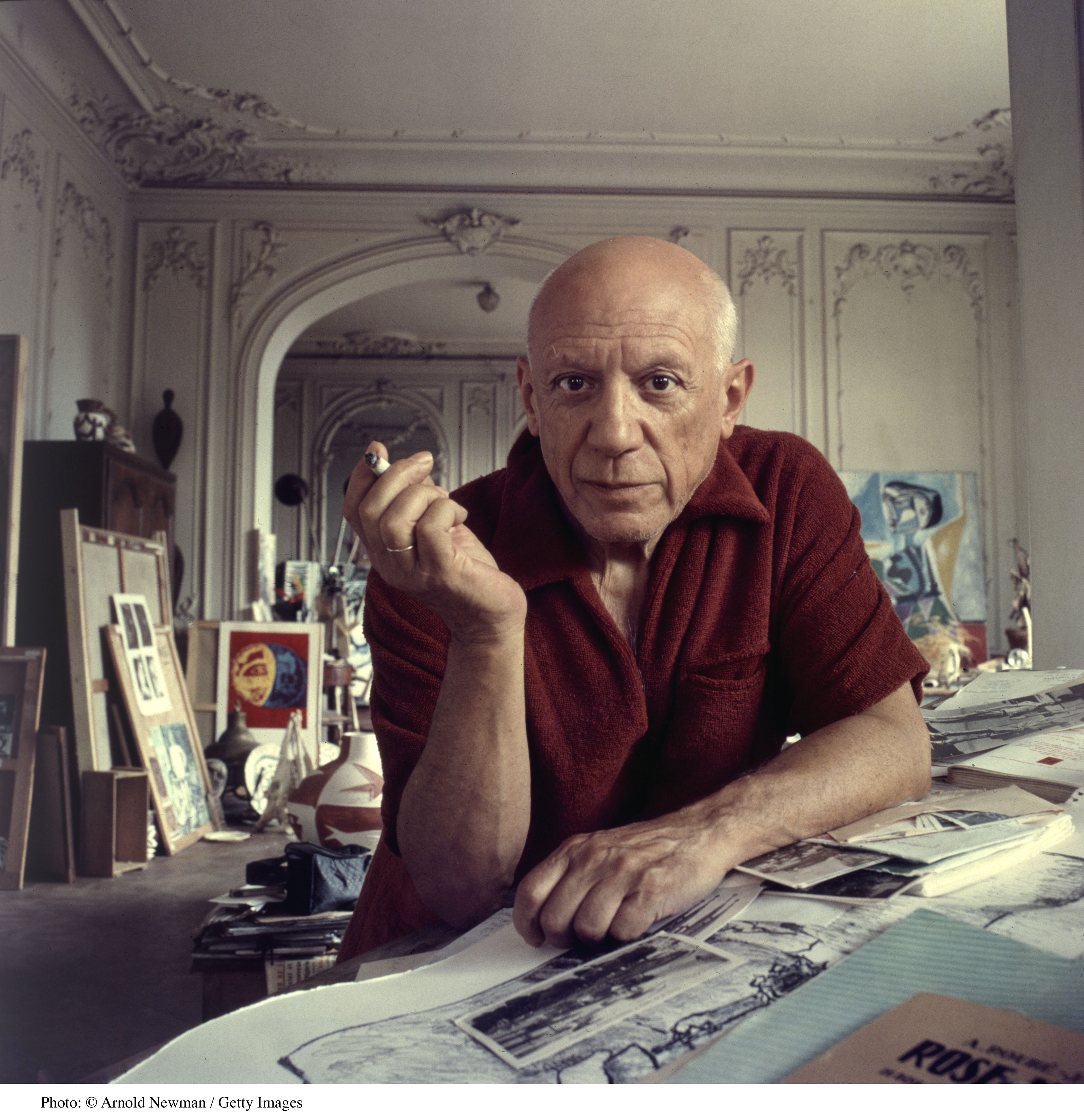Portrait of Spanish artist Pablo Picasso (1881 - 1973) as he smokes a cigarette, Cannes, France, September 11, 1956. (Photo by Arnold Newman/Getty Images)