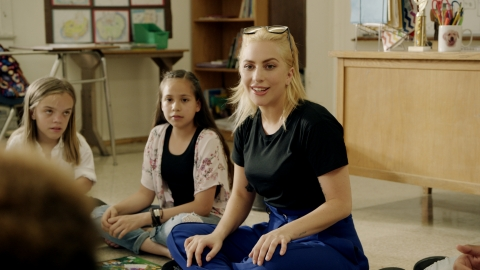 Lady Gaga is teaming up with Staples, Inc. to support education and create a positive classroom experience through its Staples for Students program. Lady Gaga recently met with students in California during the filming of the upcoming Public Service Announcement for DonorsChoose.org and Born This Way Foundation. (Photo: Business Wire)