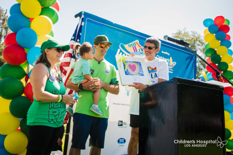 Children's Hospital Los Angeles President and CEO Paul S. Viviano honors the Becerra family, who participated in Walk L.A. in loving memory of their son Rex. Their team Rex and the Heart Beaters raised more than $106,000 to date for CHLA. (Photo: Business Wire)