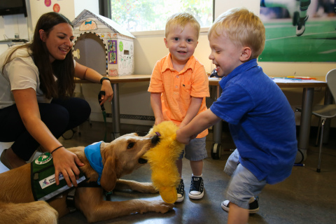 Twins Aiden and Mason, 2, snuggle up to Professor Bunsen Honeydew, an 18-month-old golden doodle and facility dog at Kravis Children's Hospital at Mount Sinai in New York, June 21, 2017. PetSmart Charities, the leading funder of animal welfare in North America, announced a grant for more than $350,000 to help launch the Paws and Play program and hire Professor to comfort patients, like Aiden, at the hospital. It is the first of its kind in the state of New York to pair a Certified Child Life Specialist with a trained facility dog to provide Animal-Assisted Therapy (AAT). (Photo: Business Wire)