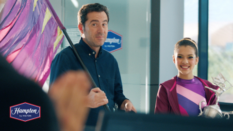Hampton by Hilton brings 'Real Travel' to life across various channels showcasing how the brand is there for those real business and family travel moments, as seen in the 'Flag Dancing' spot. (Photo: Business Wire)