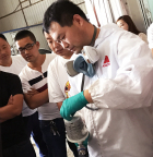 Axalta technician demonstrates best practice use of Cromax Pro waterborne refinish products. (Photo: Axalta)