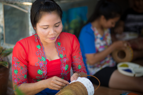 Wayan is a Balinese artisan who specializes in batik and beaded baskets and handbags. She uses her Kiva loan to invest in the purchase of such raw materials as beads and baskets for production. Photographer: Brandon Smith