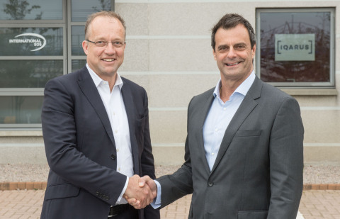 Tim Mitchell, CEO Iqarus and Michael Gardner, Group Director Medical Services at International SOS celebrate the new Joint Venture Partnership, 'Iqarus, In Association with International SOS'. (Photo: Business Wire)