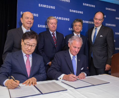In this photograph provided by Samsung Electronics America, U.S. Secretary of Commerce Wilbur Ross (standing left),  Senator Lindsey Graham (standing left center), Korean Vice Minister of Trade, Industry & Energy Inho Lee (standing right center), Samsung Electronics America President & CEO Tim Baxter (standing right), Samsung Electronics President & CEO of Consumer Electronics Boo-Keun Yoon (seated left) and South Carolina Governor Henry McMaster (seated right) announce plans to open a Samsung manufacturing facility in Newberry, S.C., Wednesday June 28th, 2017 in Washington, D.C. The plant is slated to bring 954 jobs to the region by 2020. (Photo: Business Wire)