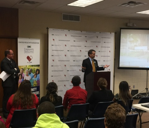 Kevin Sparks, CEO, UnitedHealthcare Community Plan of Kansas (left), listens to Kansas Lt. Gov. Jeff Colyer speak to more than 100 local residents at the Community Health Council of Wyandotte County headquarters during a ceremony yesterday to honor local community health workers. Since August 2016, more than 1,000 Wyandotte County patients who are uninsured or underinsured received enhanced, personalized care from CHC community health workers through a three-year, $1.9 million partnership with United Health Foundation (Photo: Garrett Kasper).