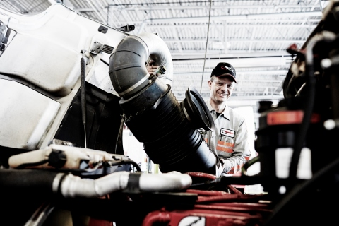 A Ryder technician performing a scheduled preventive maintenance checkup on a Ryder pre-owned vehicl ...